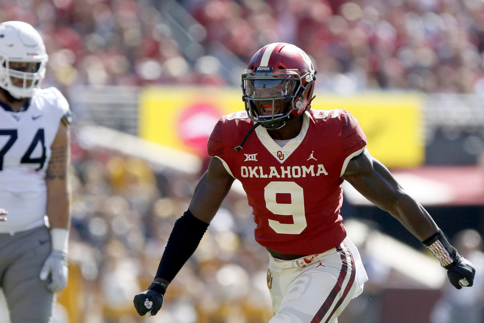 Photo - Oklahoma's Kenneth Murray (9) celebrates during a college football game between the University of Oklahoma Sooners (OU) and the West Virginia Mountaineers at Gaylord Family-Oklahoma Memorial Stadium in Norman, Okla, Saturday, Oct. 19, 2019. Oklahoma won 52-14. [Bryan Terry/The Oklahoman]