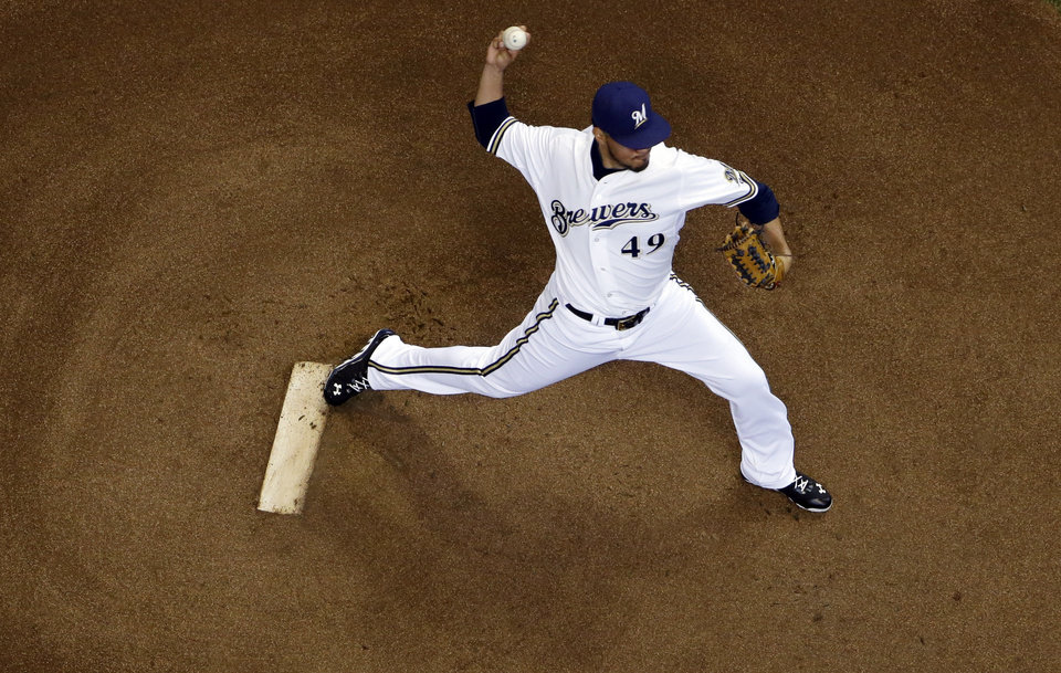 Photo - Milwaukee Brewers starting pitcher Yovani Gallardo throws during the first inning of a baseball game against the Pittsburgh Pirates Thursday, May 15, 2014, in Milwaukee. (AP Photo/Morry Gash)