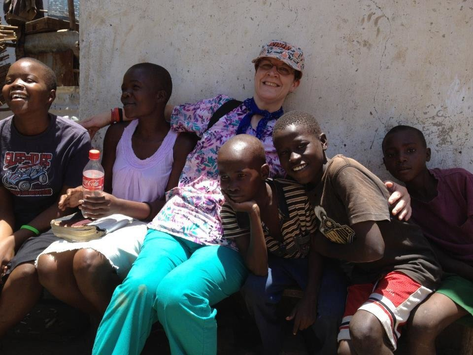 Linda Lumry, a member of Choctaw Road Baptist Church, poses with children during the church's mission trip to Kenya. Photo provided <strong></strong>