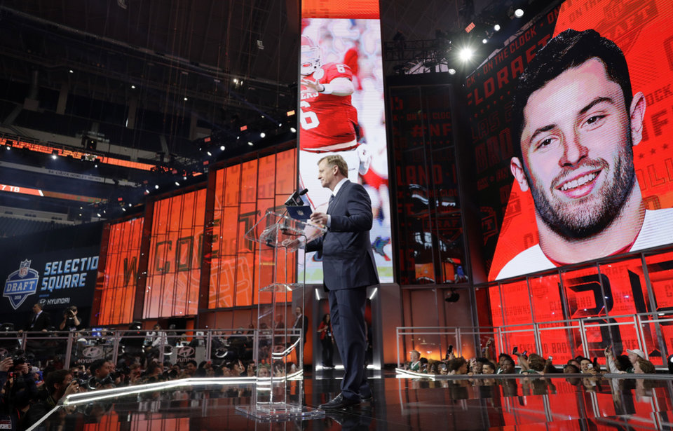 Photo - Commissioner Roger Goodell speaks at the podium after the Cleveland Browns selected Oklahoma's Baker Mayfield as their pick during the first round of the NFL football draft, Thursday, April 26, 2018, in Arlington, Texas. (AP Photo/David J. Phillip)