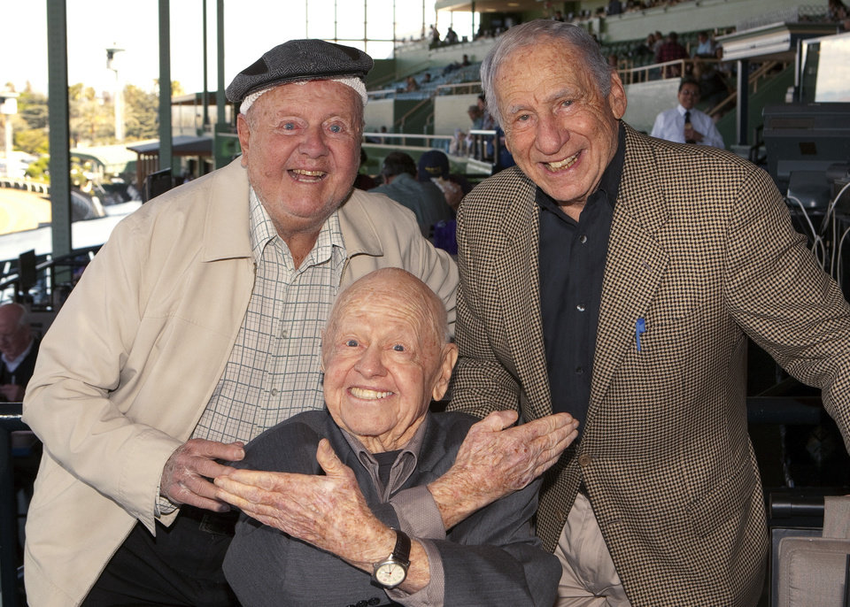 Photo - FILE - In this Sunday, March 30, 2014, file photo, entertainment icons Dick Van Patten, left, and Mel Brooks flank Mickey Rooney at Santa Anita Park, in Arcadia Calif. Rooney, a Hollywood legend whose career spanned more than 80 years, has died. He was 93. Los Angeles Police Commander Andrew Smith said that Rooney was with his family when he died Sunday, April 6, 2014, at his North Hollywood home. (AP Photo/Benoit Photo, File)