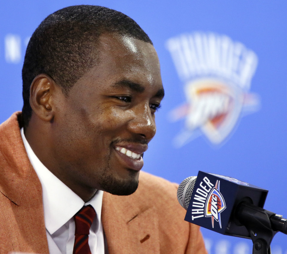 Photo - Serge Ibaka of the Oklahoma City Thunder NBA basketball team smiles as he speaks at a press conference about his new contract to stay with the Thunder, at the Boys and Girls Club of Oklahoma County, Monday, Sept. 10, 2012. Photo by Nate Billings, The Oklahoman