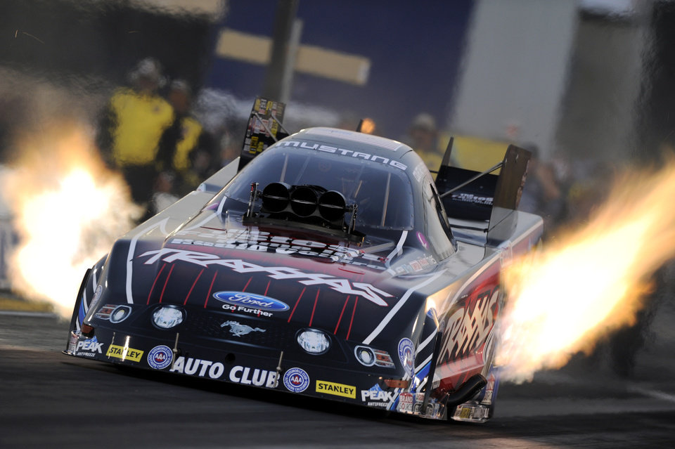 Photo - In this photo provided by NHRA, Funny Car driver Courtney Force secures the No. 1 qualifying position at the NHRA Sonoma Nationals drag races at Sonoma Raceway on Friday, July 25, 2014, in Sonoma, Calif. (AP Photo/NHRA, Marc Gewertz)
