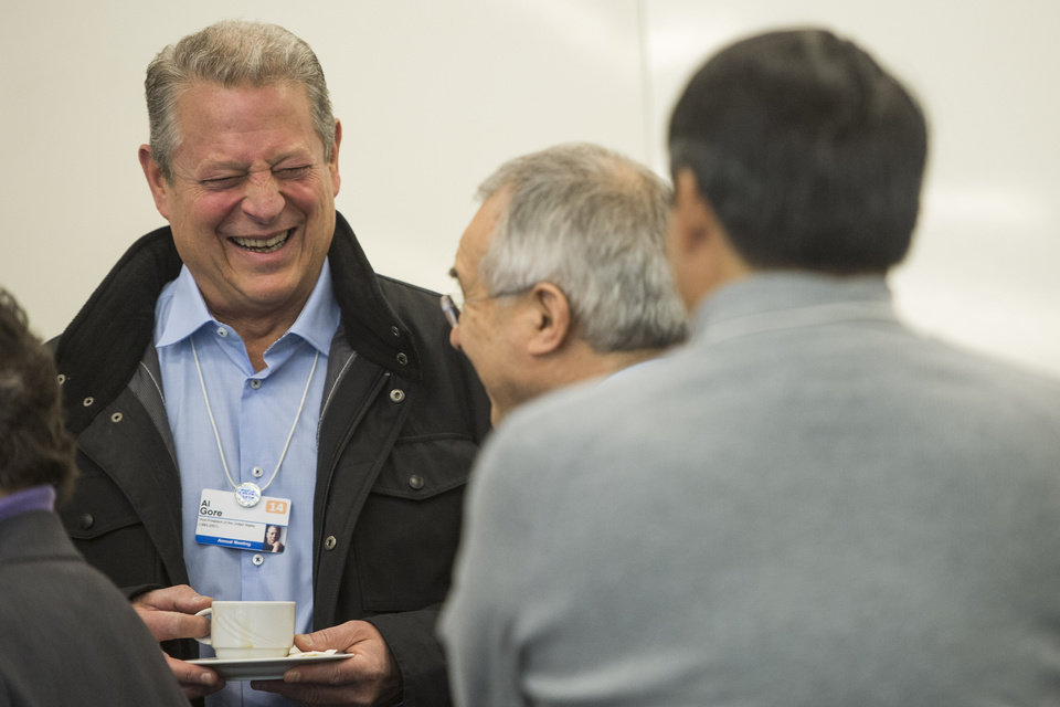 Photo - Al Gore, former Vice-President of the United States, laughs prior to  a panel session during the opening  day of the 44. Annual Meeting of the World Economic Forum, WEF, in Davos, Switzerland, Wednesday, Jan.  22, 2014. (AP Photo/Keystone,Jean-Christophe Bott)
