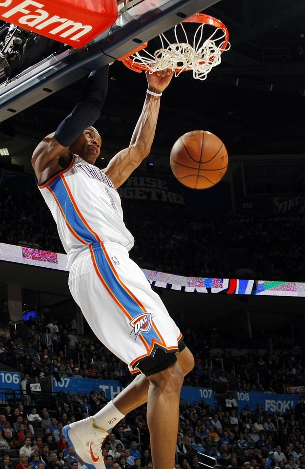 Oklahoma City's Russell Westbrook (0) dunks the ball during the NBA basketball game between the Sacramento Kings and the Oklahoma City Thunder at the Oklahoma City Arena in Oklahoma City, Friday, December 17, 2010. Photo by Nate Billings, The Oklahoman