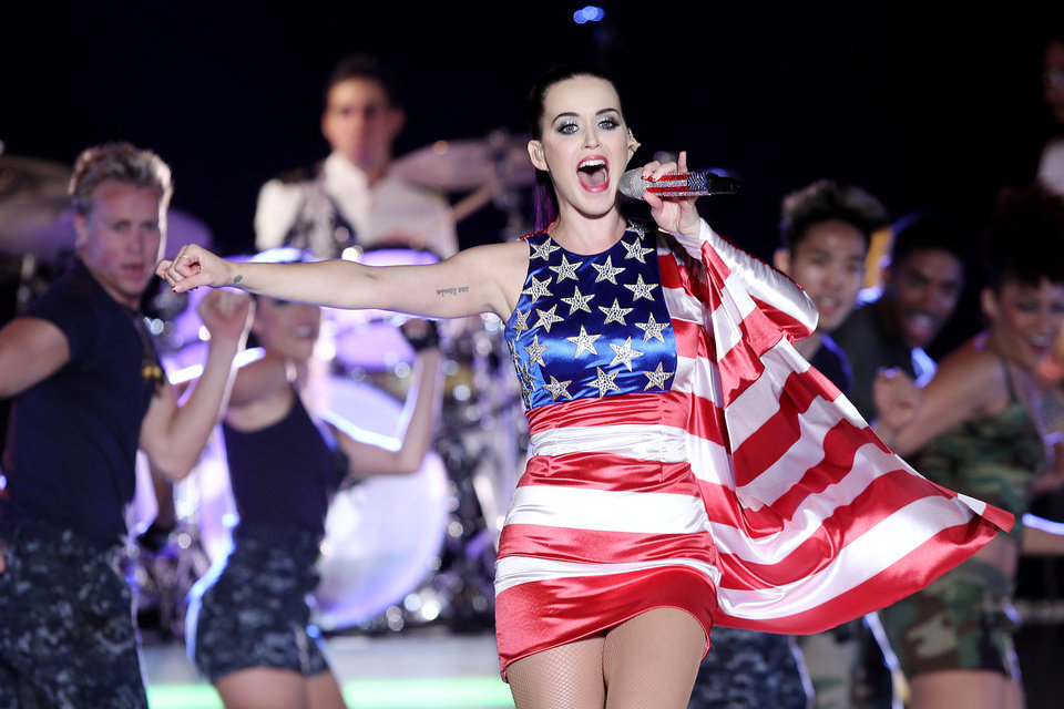 Photo -   FILE - In this May 23, 2012 file photo released by Starpix, singer Katy Perry wears a patriotic dress as she performs at a Pepsi-sponsored event at Brooklyn Pier 9A, kicking off Fleet Week in New York. Perry's