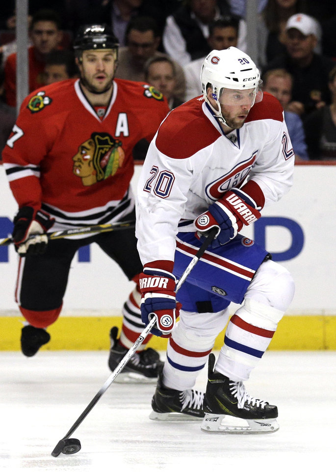 Photo - Montreal Canadiens' Thomas Vanek (20) looks to a pass during the first period of an NHL hockey game against the Chicago Blackhawks in Chicago, Wednesday, April 9, 2014. (AP Photo/Nam Y. Huh)