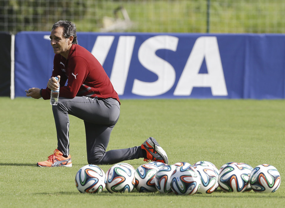 Photo - Italy coach Cesare Prandelli watches his players during a training session of Italy in Mangaratiba, Brazil, Monday, June 16, 2014. Italy play in group D of the 2014 soccer World Cup. (AP Photo/Antonio Calanni)