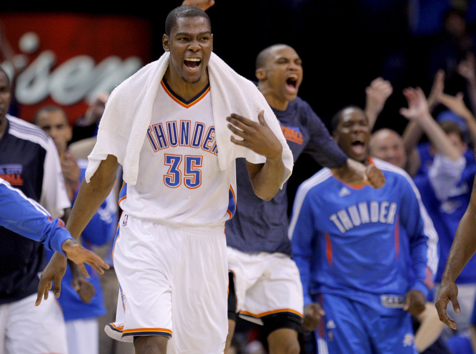 Photo - Oklahoma City's Kevin Durant (35) and  Russell Westbrook (0) react during game two of the Western Conference semifinals between the Memphis Grizzlies and the Oklahoma City Thunder in the NBA basketball playoffs at Oklahoma City Arena in Oklahoma City, Tuesday, May 3, 2011. Photo by Bryan Terry, The Oklahoman