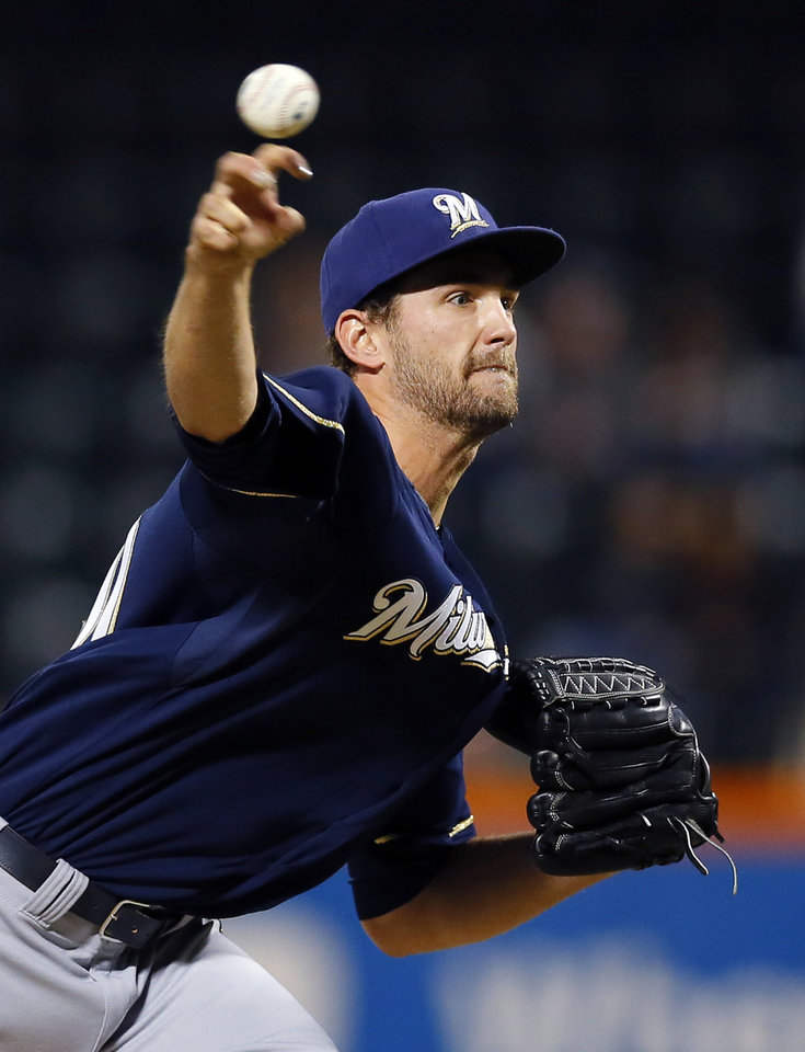 Photo - Milwaukee Brewers starting pitcher Johnny Hellweg (40) throws in the first inning of a baseball game against the New York Mets at Citi Field in New York, Thursday, Sept. 26, 2013. (AP Photo/Paul J. Bereswill)