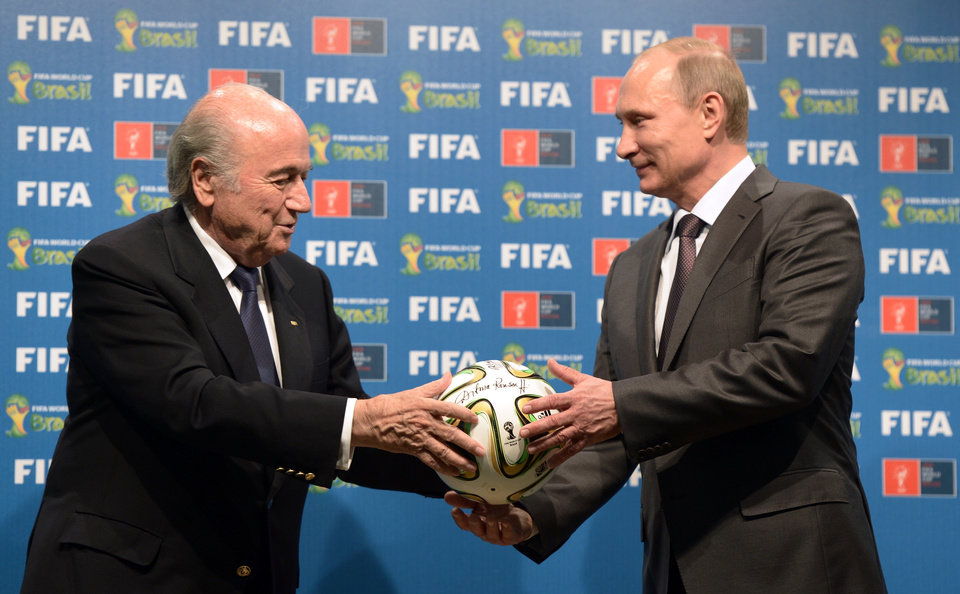 Photo - FILE - In this file photo taken on Sunday, July 13, 2014, FIFA President Sepp Blatter, left, and Russian President Vladimir Putin hold a soccer ball during the official ceremony of handover to Russia as the 2018 World Cup hosts, after the World Cup final soccer match between Germany and Argentina at the Maracana Stadium in Rio de Janeiro, Brazil. (AP Photo/RIA-Novosti, Alexei Nikolsky, Presidential Press Service, File)