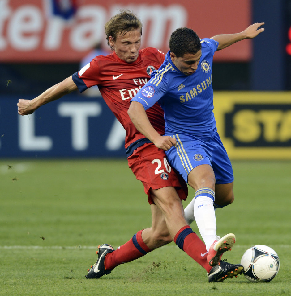 Photo -   Chelsea FC's Eden Hazard, right, and Paris Saint-Germain's Clement Chantome compete for the ball during the first half of their exhibition soccer match at Yankee Stadium in New York, Sunday, July 22, 2012. (AP Photo/Henny Ray Abrams)