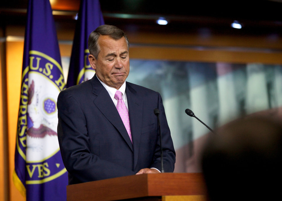 Photo - House Speaker John Boehner of Ohio listens to a reporters question during a news conference on Capitol Hill in Washington, Thursday, Nov. 14, 2013. Speaking about the Affordable Care Act, Boehner insisted it was time to