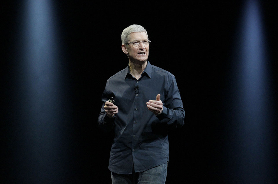 Photo - Apple CEO Tim Cook speaks at the Apple Worldwide Developers Conference event in San Francisco, Monday, June 2, 2014. (AP Photo/Jeff Chiu)