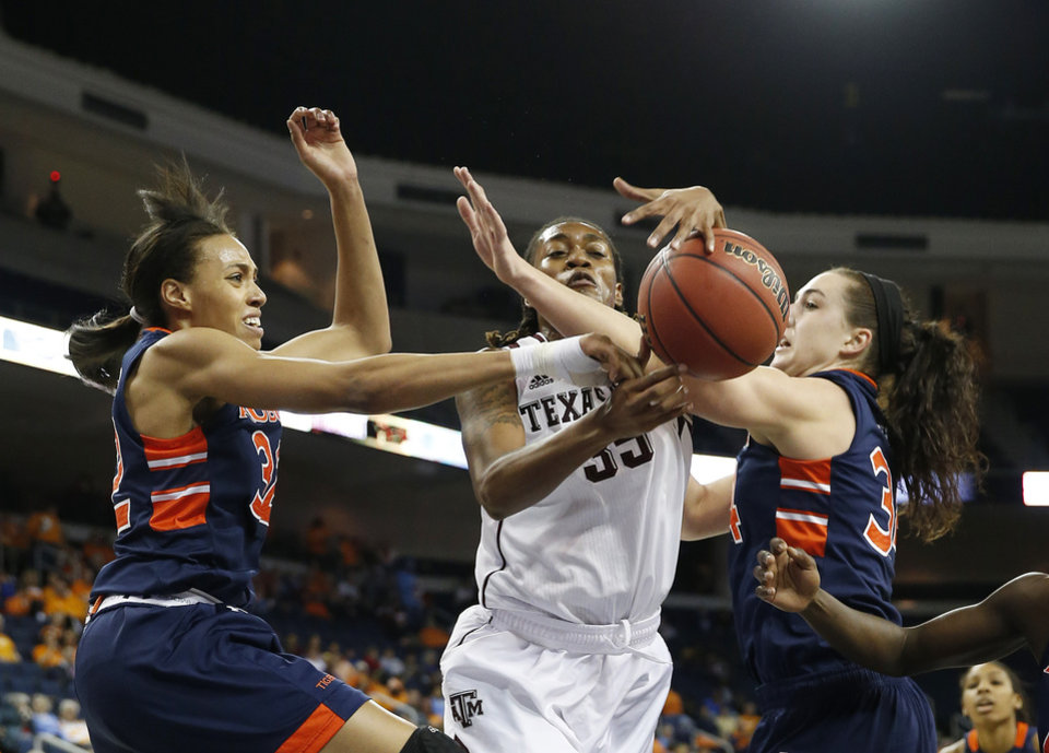 Photo - Texas A&M forward Achiri Ade (35) competes with Auburn's Tyrese Tanner, left, and Peyton Davis for a rebound in the first half in an NCAA college basketball game in the quarterfinals of the Southeastern Conference women's tournament, Friday, March 7, 2014, in Duluth, Ga. (AP Photo/John Bazemore)