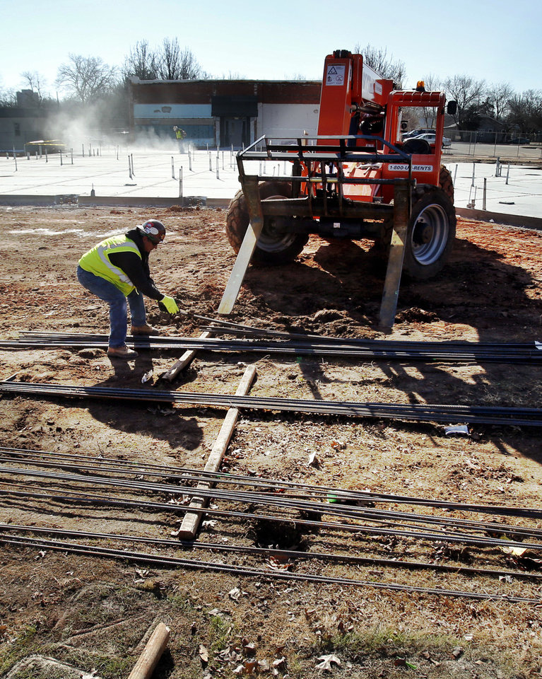 Construction workers lay the groundwork for a new Administrative Services Center building for the Norman school district at 131 S Flood Ave. PHOTO BY STEVE SISNEY, THE OKLAHOMAN