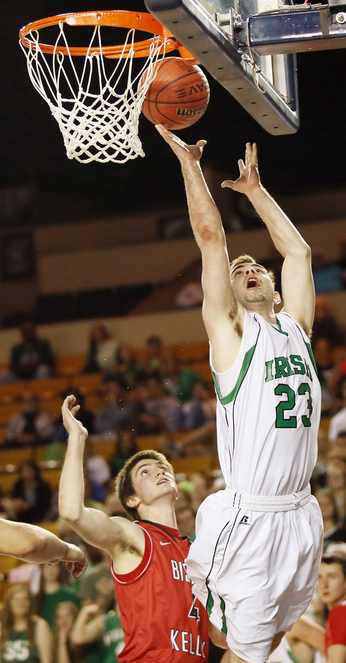 Photo - Stephen Amalong (23) of Bishop McGuinness takes a shot in front of Josh Limes (4) of Bishop Kelley during a Class 5A boys semifinal game in the state basketball championship tournament between Bishop McGuinness and Bishop Kelley at the Mabee Center in Tulsa, Okla., Friday, March 14, 2014. Photo by Nate Billings, The Oklahoman