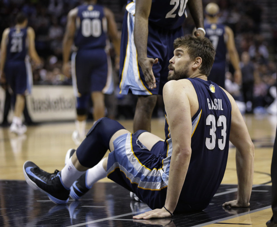 Photo - Memphis Grizzlies' Marc Gasol looks for a foul call after he fell to the floor during the second half in Game 1 of a Western Conference Finals NBA basketball playoff series against the San Antonio Spurs Sunday, May 19, 2013, in San Antonio. (AP Photo/Eric Gay)