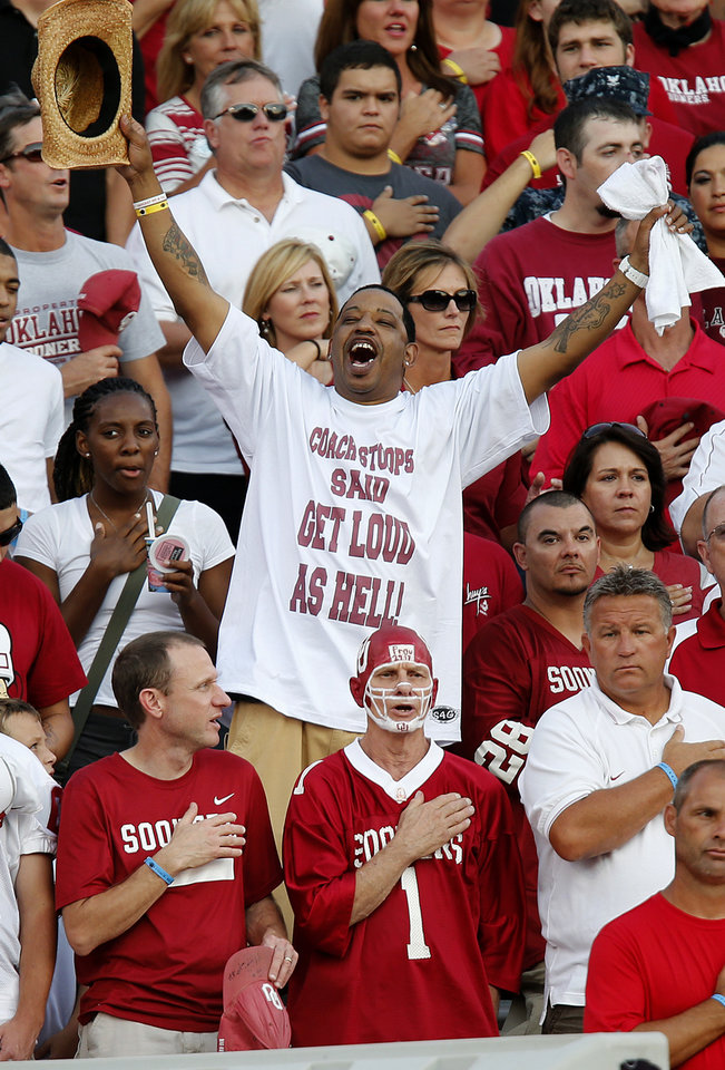 Photo - Sooner fans get ready for the start of the game during the college football game between the University of Oklahoma Sooners (OU) and the Kansas State University Wildcats (KSU) at the Gaylord Family-Memorial Stadium on Saturday, Sept. 22, 2012, in Norman, Okla. Photo by Chris Landsberger, The Oklahoman