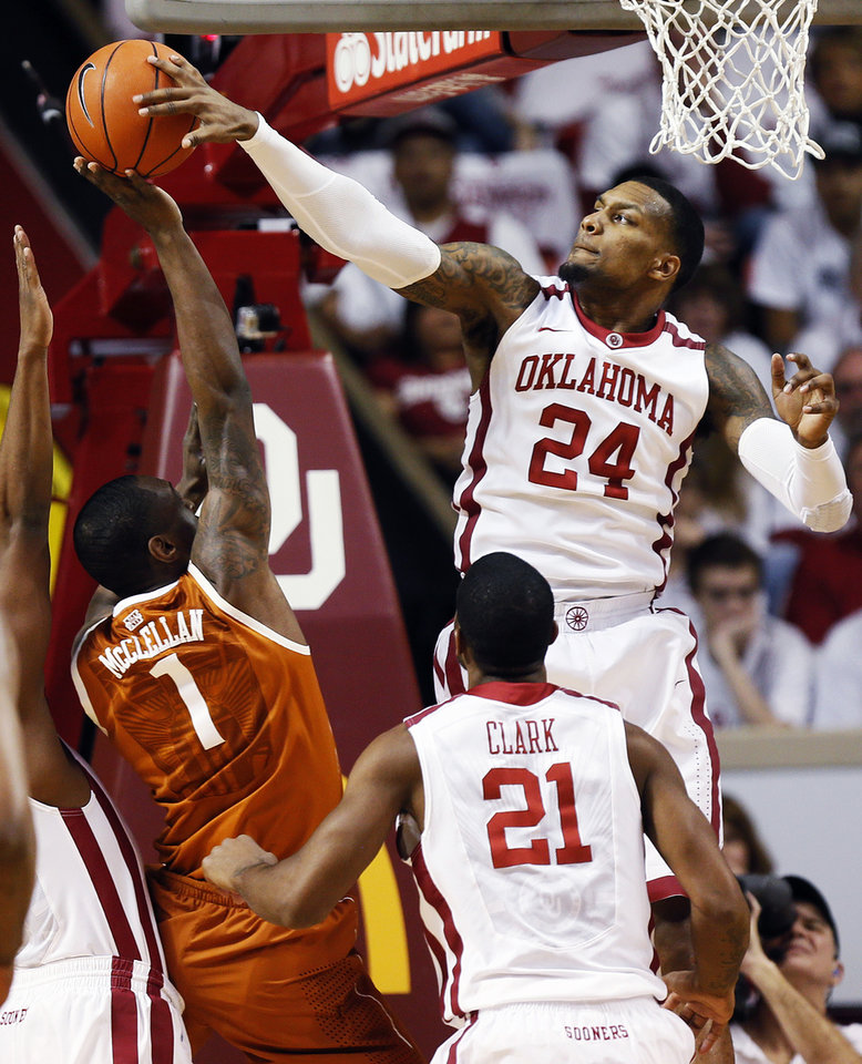 Photo - Oklahoma's Romero Osby (24) blocks a shot by Texas' Sheldon McClellan (1) as Oklahoma's Cameron Clark (21) watches during their NCAA college basketball game, Monday, Jan. 21, 2013, in Norman, Okla. (AP Photo/The Oklahoman, Nate Billings) LOCAL TV OUT (KFOR, KOCO, KWTV, KOKH, KAUT OUT); LOCAL INTERNET OUT; LOCAL PRINT OUT (EDMOND SUN OUT, OKLAHOMA GAZETTE OUT) TABLOIDS OUT