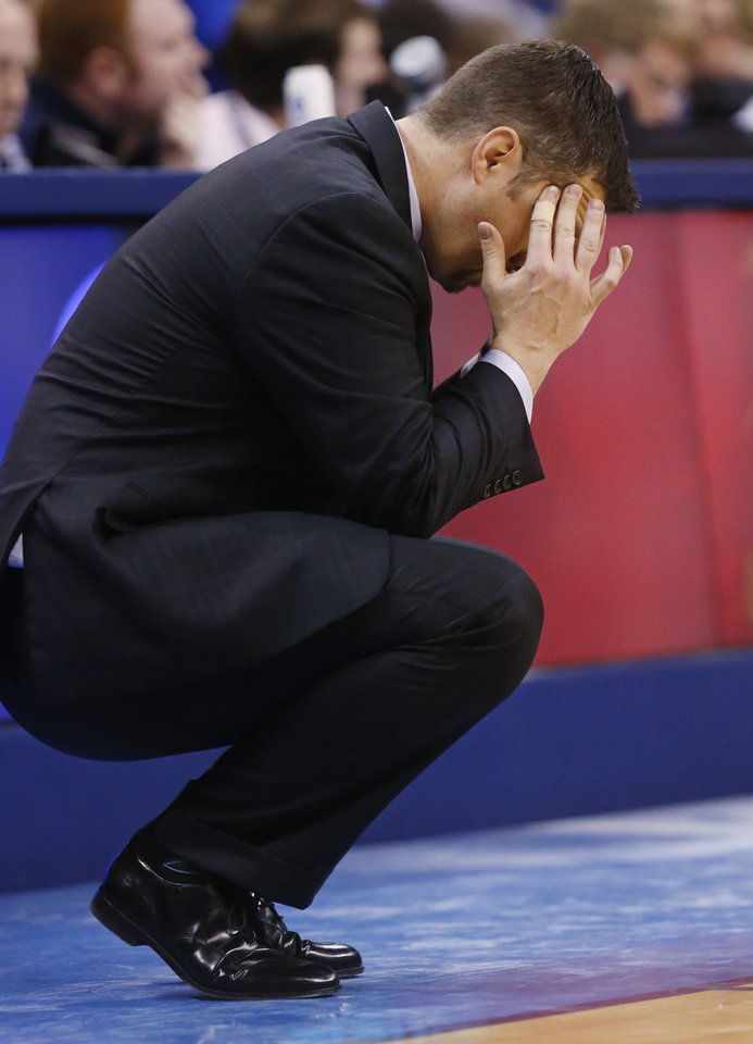 Photo - Memphis Grizzlies coach David Joerger rubs his head on the sideline during the second quarter of the Grizzlies' NBA basketball game against the Oklahoma City Thunder in Oklahoma City, Friday, Feb. 28, 2014. (AP Photo/Sue Ogrocki)