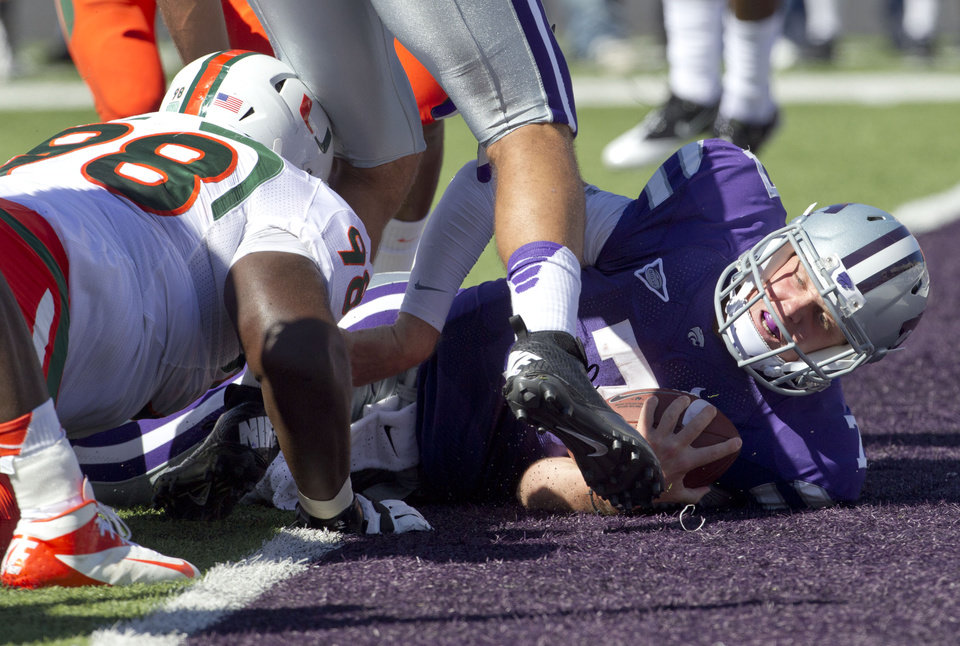 Photo -  Why Kansas State will win  1. Offensive systems could favor Kansas State:  Many of Kansas State's struggles against North Texas stemmed from the Mean Green keeping possession of the ball over 14 minutes more than the Wildcats. That sort of game plan ? that kept Collin Klein on the sideline ? doesn't suit Oklahoma's offense. If OU has a couple early three-and-outs, and K-State can sustain long drives by powering through OU's run defense, it could spell trouble for the Sooners.    Photo:  Kansas State quarterback Collin Klein (7) lands in the end zone past Miami defensive lineman Darius Smith (98) during the first half of an NCAA football game in Manhattan, Kan., Saturday, Sept. 8, 2012. (AP Photo/Orlin Wagner)
