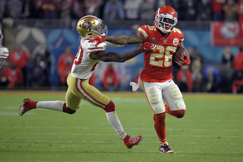 Photo - Kansas City Chiefs' Damien Williams, right, pulls away from San Francisco 49ers' Jimmie Ward on his way to the winning touchdown during the second half of the NFL Super Bowl 54 football game Sunday, Feb. 2, 2020, in Miami Gardens, Fla. (AP Photo/Mark J. Terrill)