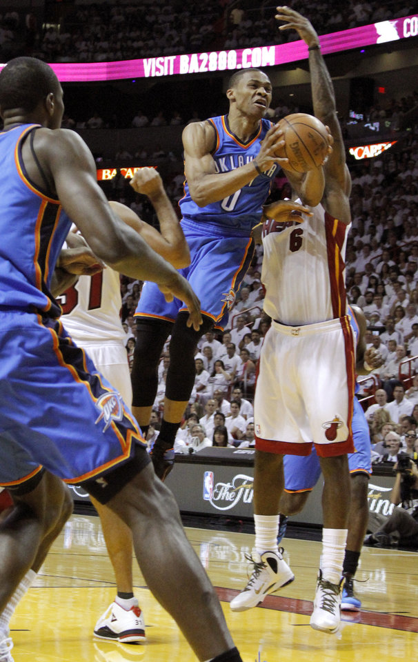 Oklahoma City's Russell Westbrook (0) leaps past Miami's LeBron James (6) during Game 3 of the NBA Finals between the Oklahoma City Thunder and the Miami Heat at American Airlines Arena, Sunday, June 17, 2012. Photo by Bryan Terry, The Oklahoman