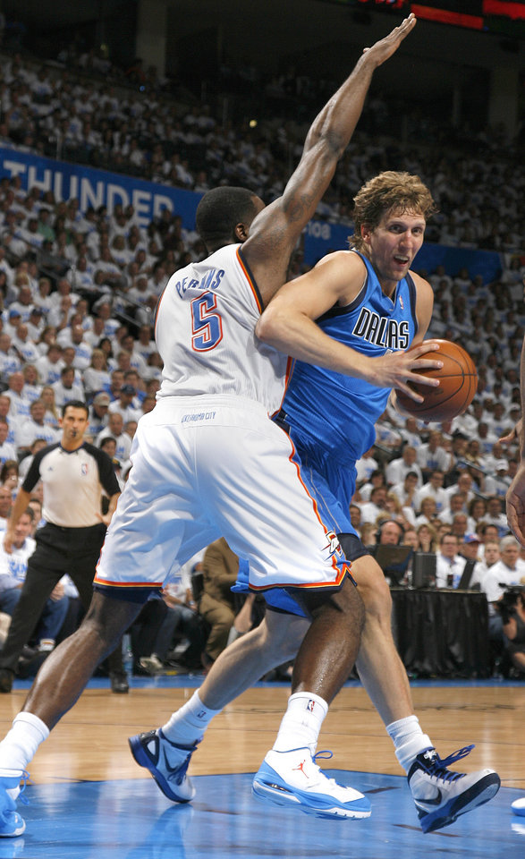 Dallas\' Dirk Nowitzki (41) tries to get around Oklahoma City\'s Serge Ibaka (9) during Game 2 of the first round in the NBA basketball playoffs between the Oklahoma City Thunder and the Dallas Mavericks at Chesapeake Energy Arena in Oklahoma City, Monday, April 30, 2012. Photo by Sarah Phipps, The Oklahoman