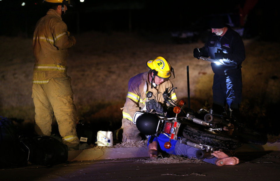 Edmond firefighters train during a nighttime crash scenario.  Photos by Sarah Phipps, The Oklahoman