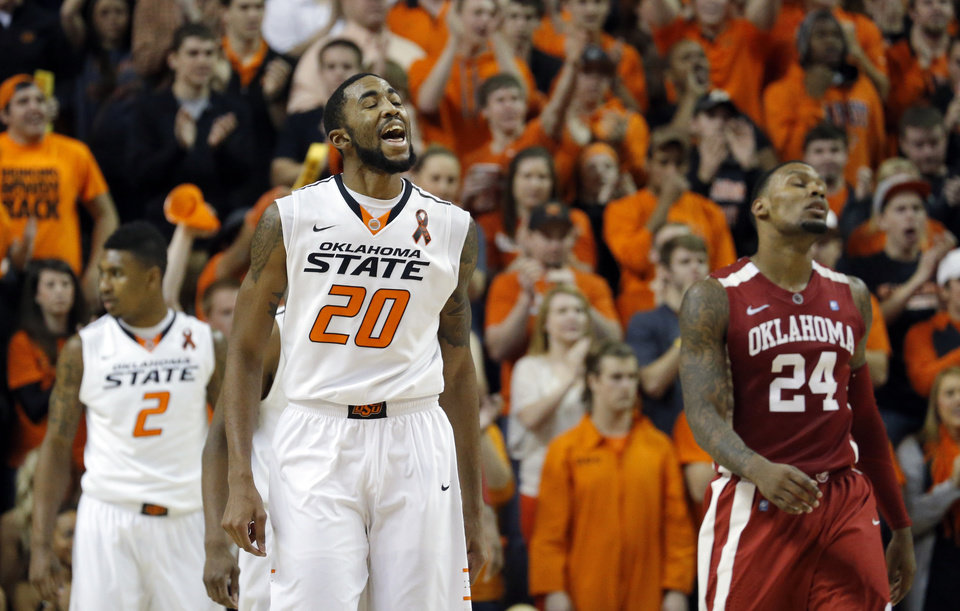 Oklahoma State\'s Michael Cobbins (20) celebrates in front of Oklahoma\'s Romero Osby (24) during the Bedlam men\'s college basketball game between the Oklahoma State University Cowboys and the University of Oklahoma Sooners at Gallagher-Iba Arena in Stillwater, Okla., Saturday, Feb. 16, 2013. Photo by Sarah Phipps, The Oklahoman