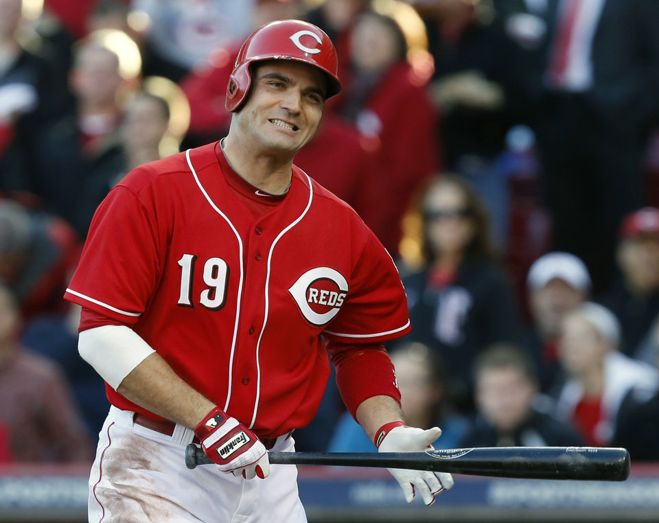 Cincinnati Reds' Joey Votto grimaces after striking out in the fourth inning of Game 4 of the National League division baseball series against the San Francisco Giants, Wednesday, Oct. 10, 2012, in Cincinnati. (AP Photo/David Kohl)