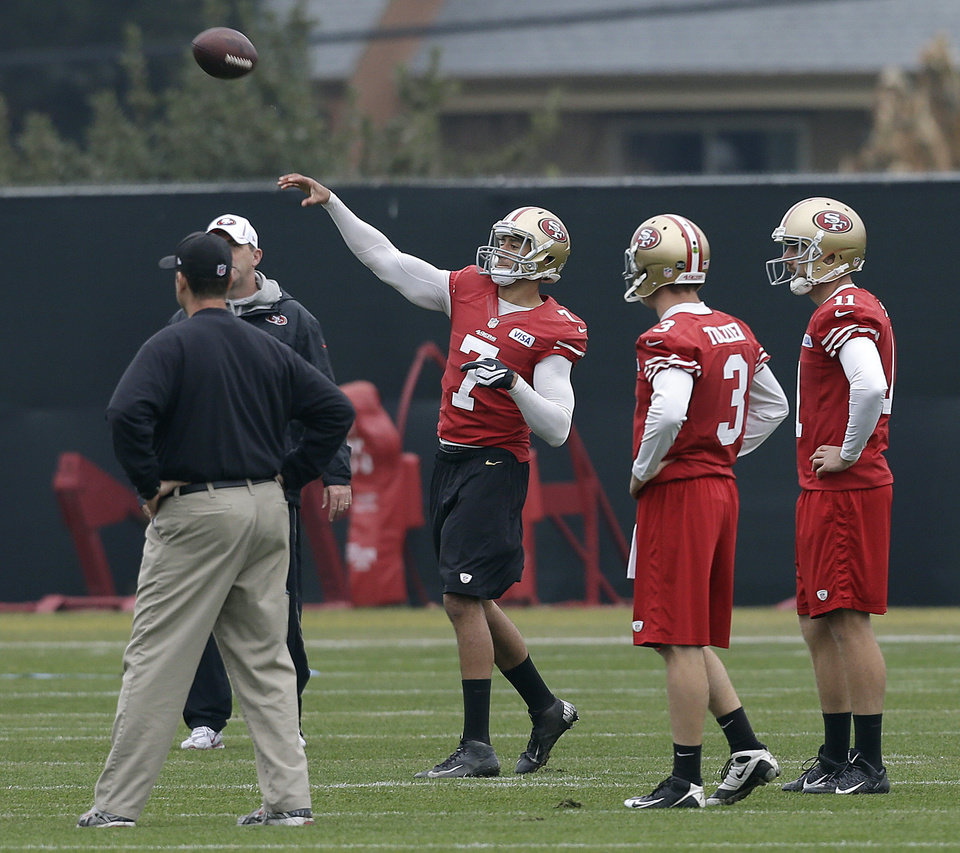San Francisco 49ers quarterback Colin Kaepernick (7) throws a pass as head coach Jim Harbaugh, left, and quarterbacs Scott Tolzien (3) and Alex Smith 11) watch during NFL football practice at the team\'s training facility in Santa Clara, Calif., Wednesday, Jan. 23, 2013. The 49ers are scheduled to play the Baltimore Ravens in the Super Bowl XLVII on Sunday, Feb. 3 in New Orleans. (AP Photo/Jeff Chiu)