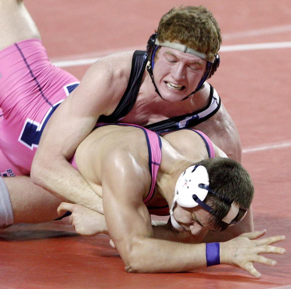 Photo - Deer Creek's Nolan Boyd, top, wrestles Altus' Drake Martel in the Class 5A 171-pound match in the state wrestling tournament at State Fair Arena, Saturday, Feb. 26, 2011. Photo by Bryan Terry, The Oklahoman