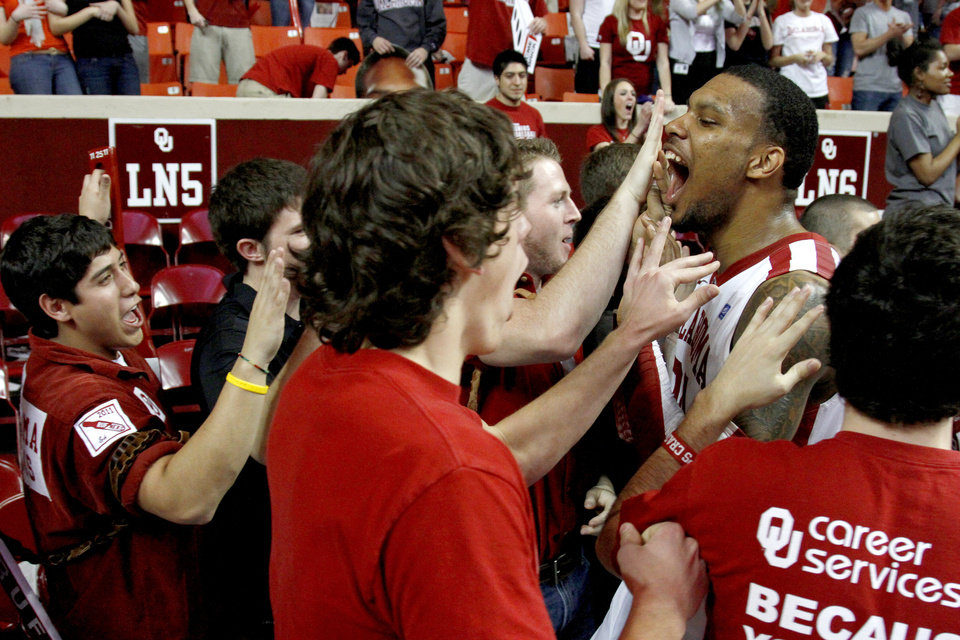 Oklahoma's Romero Osby (24) celebrates with fans after the Bedlam men's college basketball game between the University of Oklahoma Sooners and the Oklahoma State Cowboys in Norman, Okla., Wednesday, Feb. 22, 2012. Oklahoma won 77-64. Photo by Bryan Terry, The Oklahoman