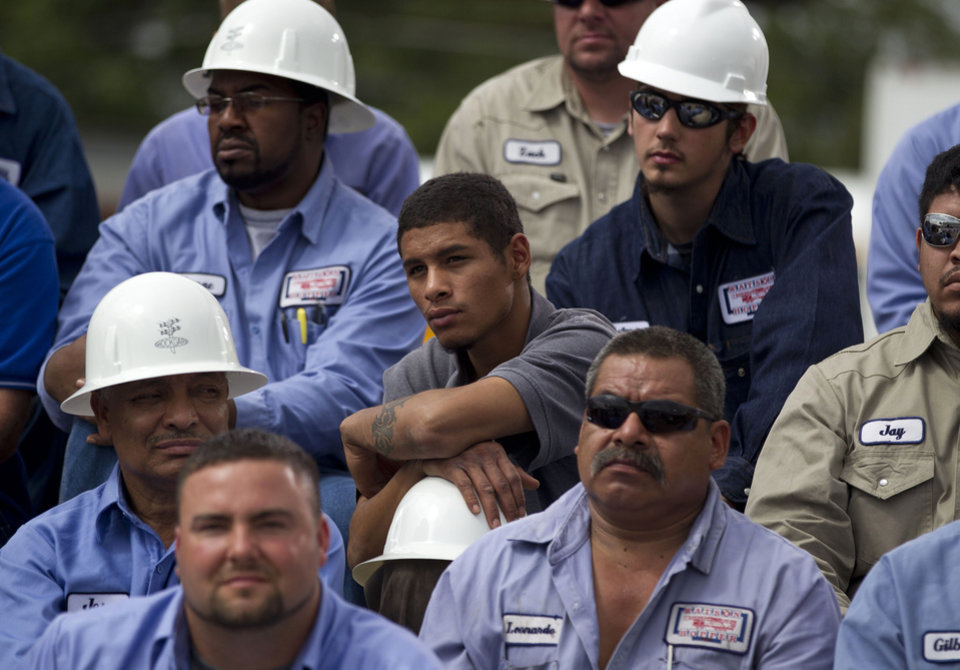 Photo -   Employees of Watson Truck and Supply watch as Republican presidential candidate, former Massachusetts Gov. Mitt Romney speaks during a campaign stop, Thursday, Aug. 23, 2012, in Hobbs, N.M. (AP Photo/Evan Vucci)