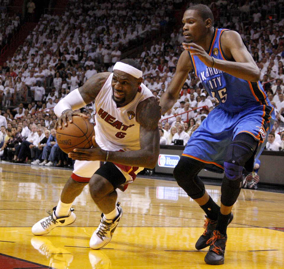 Photo - Miami's LeBron James (6) falls down in front of Oklahoma City's Kevin Durant (35) during Game 4 of the NBA Finals between the Oklahoma City Thunder and the Miami Heat at American Airlines Arena, Tuesday, June 19, 2012. Oklahoma City lost 104-98.  Photo by Bryan Terry, The Oklahoman