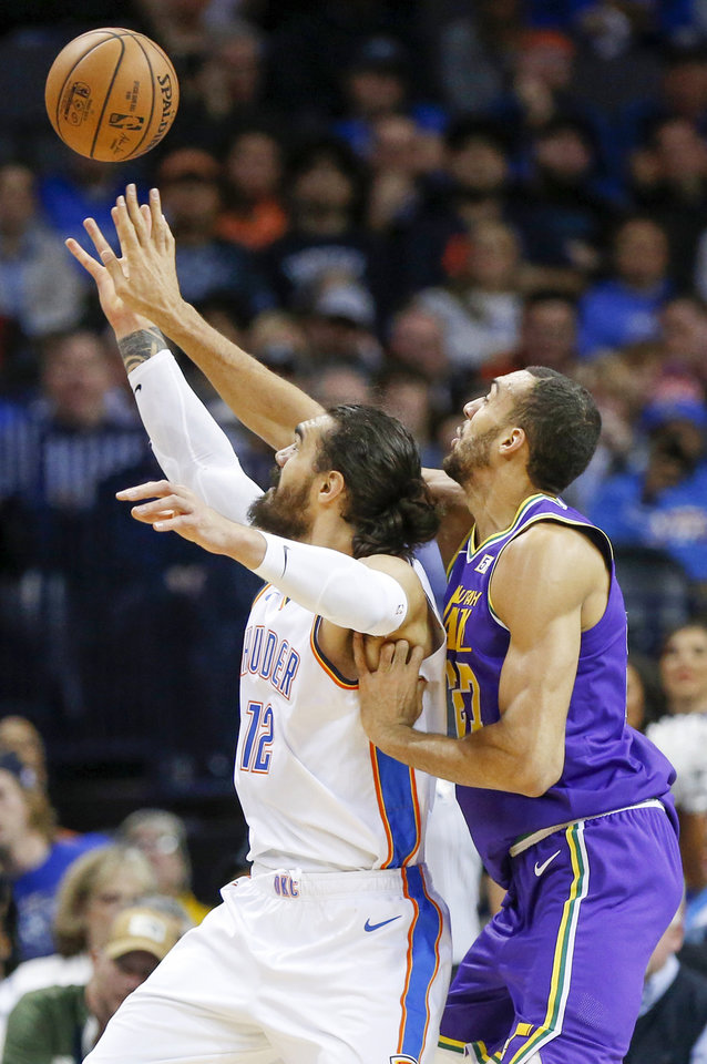 Photo - Utah's Rudy Gobert (27), right, tries to deflect a pass intended for Oklahoma City's Steven Adams (12) during an NBA basketball game between the Utah Jazz and the Oklahoma City Thunder at Chesapeake Energy Arena in Oklahoma City, Monday, Dec. 10, 2018. Photo by Nate Billings, The Oklahoman