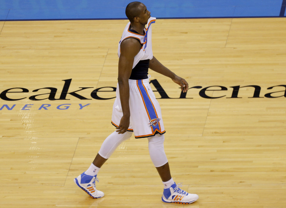 Photo - Oklahoma City's Serge Ibaka (9) walks off the court after loosing in overtime during Game 2 in the first round of the NBA playoffs between the Oklahoma City Thunder and the Memphis Grizzlies at Chesapeake Energy Arena in Oklahoma City, Monday, April 21, 2014. Photo by Sarah Phipps, The Oklahoman