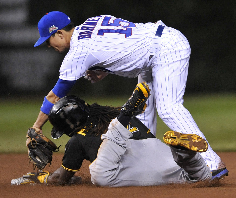 Photo - Chicago Cubs second baseman Darwin Barney (15) attempts to apply the tag while Pittsburgh Pirates' Andrew McCutchen steals second base safely during the fourth inning of a baseball game in Chicago, Saturday, June 21, 2014. (AP Photo/Paul Beaty)