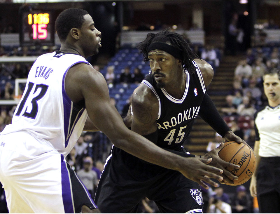 Sacramento Kings guard Tyreke Evans, left, pressures Brooklyn Nets forward Gerald Wallace during the first quarter of an NBA basketball game in Sacramento, Calif., Sunday, Nov. 18, 2012. (AP Photo/Rich Pedroncelli)