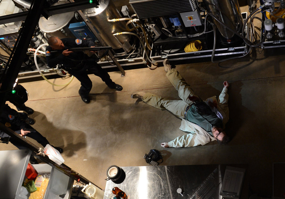 Photo - This image released by AMC shows Bryan Cranston, as Walter White, in the final scene from