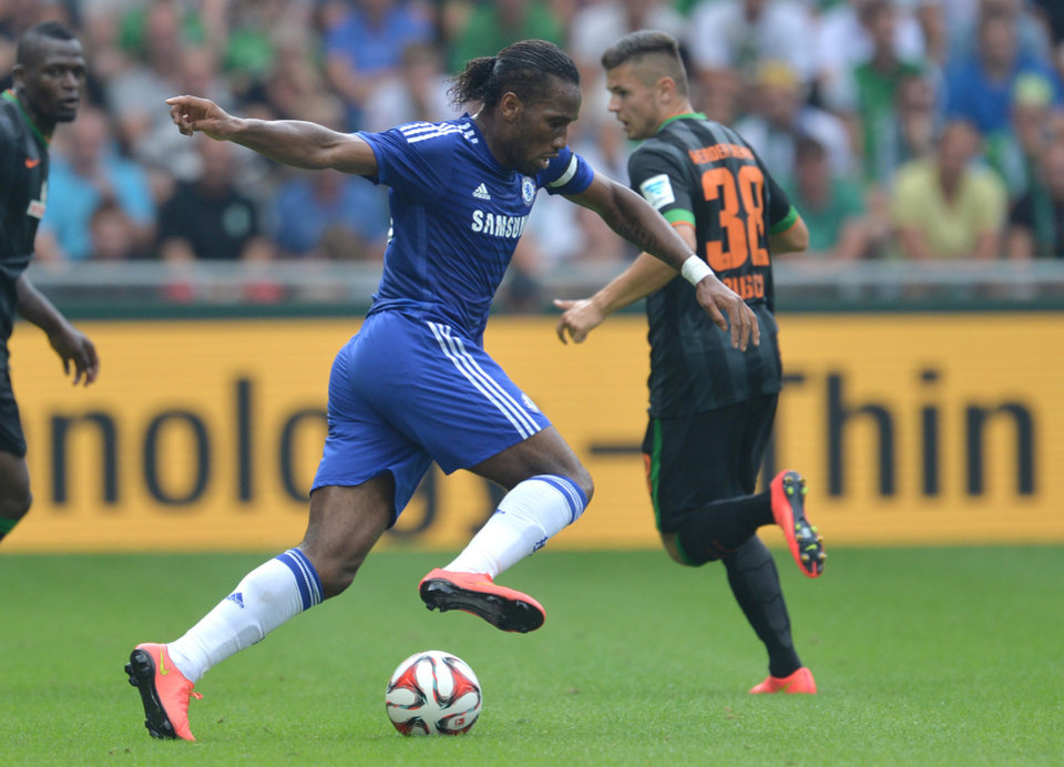 Photo - Chelsea's Didier Drogba plays the ball during  the preseason  soccer match between SV  Werder Bremen and FC Chelsea   in Bremen, Germany,  Sunday Aug. 3, 2014. Bremen won by 3-0.  (AP Photo/dpa, Carmen  Jaspersen)