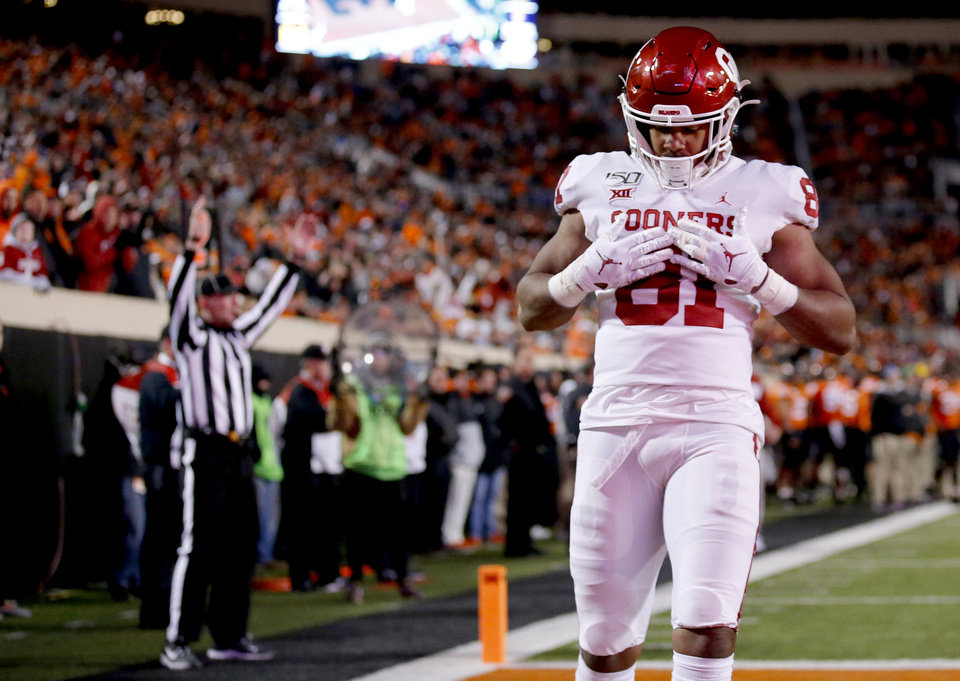 Photo - Oklahoma's Brayden Willis (81) celebrates a touchdown in the fourth quarter during the Bedlam college football game between the Oklahoma State Cowboys (OSU) and Oklahoma Sooners (OU) at Boone Pickens Stadium in Stillwater, Okla., Saturday, Nov. 30, 2019. OU won  34-16. [Sarah Phipps/The Oklahoman]