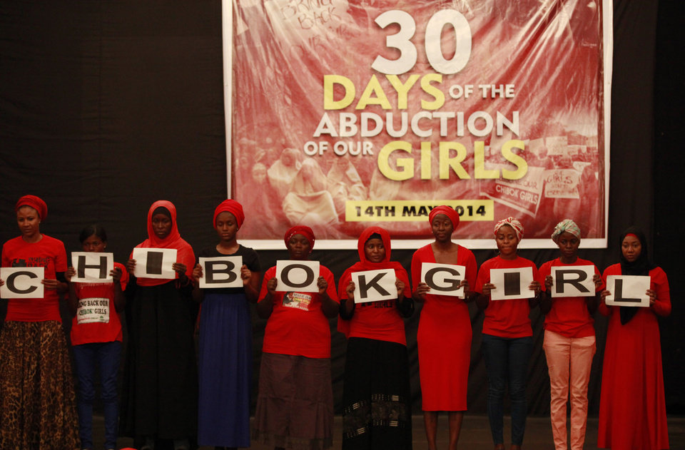 Photo - FILE- In Wednesday, May 14, 2014 file photo, people attend a vigil to mark one month since the girls of a government secondary school in Chibok were kidnapped, in Abuja, Nigeria. Islamic extremists have abducted 60 more girls and women and 31 boys from villages in northeast Nigeria, witnesses said Tuesday, June 24, Security forces denied the kidnappings. Nigeria's government and military have attracted international censure for their slow response to the abductions of more than 200 schoolgirls kidnapped April 15.(AP Photo/Sunday Alamba, File)