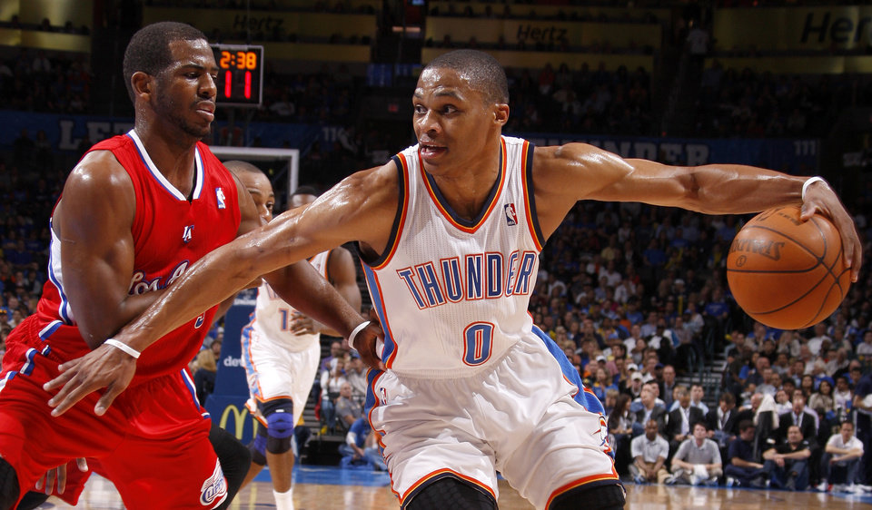 Oklahoma City\'s Russell Westbrook (0) tries to get past Los Angeles\' Chris Paul (3) during the NBA basketball game between the Oklahoma City Thunder and the Los Angeles Clippers at Chesapeake Energy Arena in Oklahoma City, Wednesday, April 11, 2012. Photo by Bryan Terry, The Oklahoman