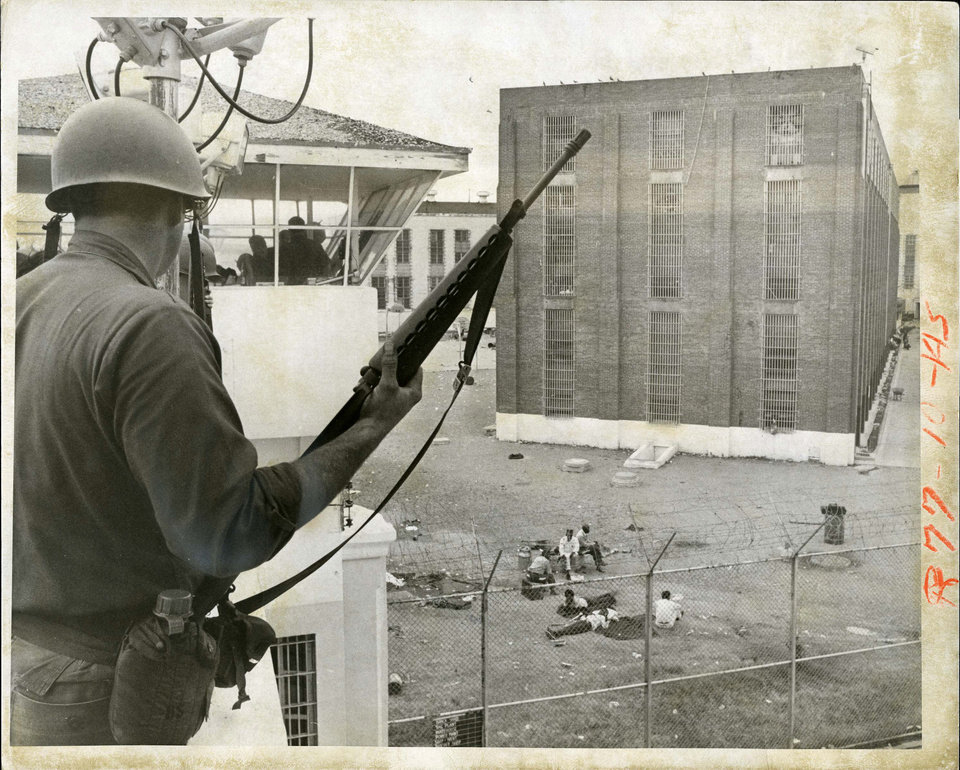 Photo - PENAL INSTITUTION / OKLAHOMA STATE PENITENTIARY / McALESTER PRISON RIOT 1973: But Saturday afternoon, the mood changed as Guardsmen joined prison guards in regaining control. Staff Photo by Jim Argo. Original photo taken 07/28/1973, published 7/29/1973 in The Daily Oklahoman       ORG XMIT: OKC1307251028543388