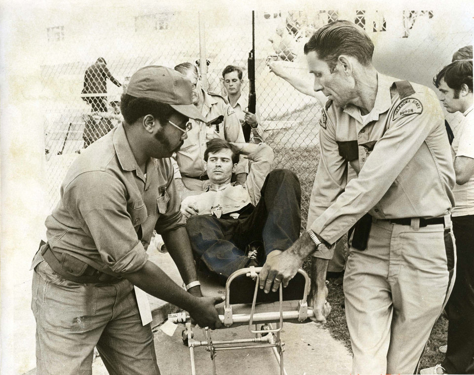 Photo - PENAL INSTITUTION / OKLAHOMA STATE PENITENTIARY / McALESTER PRISON RIOT 1973: One of the injured is removed from prison grounds on a stretcher. Staff Photo by Don Tullous. Original photo taken 07/28/1973, published 07/29/1973 in The Daily Oklahoman E. ORG XMIT: OKC1307251029023396