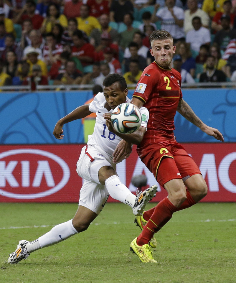 Photo - United States' Julian Green, left, scores his side's first goal during the World Cup round of 16 soccer match between Belgium and the USA at the Arena Fonte Nova in Salvador, Brazil, Tuesday, July 1, 2014. (AP Photo/Matt Dunham)