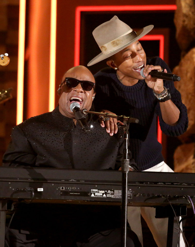 Photo - Stevie Wonder, left, and Pharrell Williams perform at the 56th annual Grammy Awards at Staples Center on Sunday, Jan. 26, 2014, in Los Angeles. (Photo by Matt Sayles/Invision/AP)